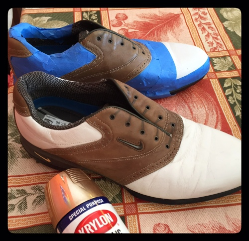 The painter's tape cost almost as much as the shoes.  I've removed the golf spikes.
